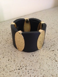 Classy black and gold gem $10