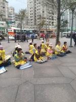 """Falun Dafa """"Dharma Wheel Practice"""" outside Taipei 101"""
