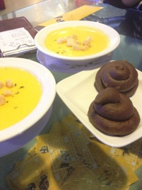 warm poop shaped bread with soup